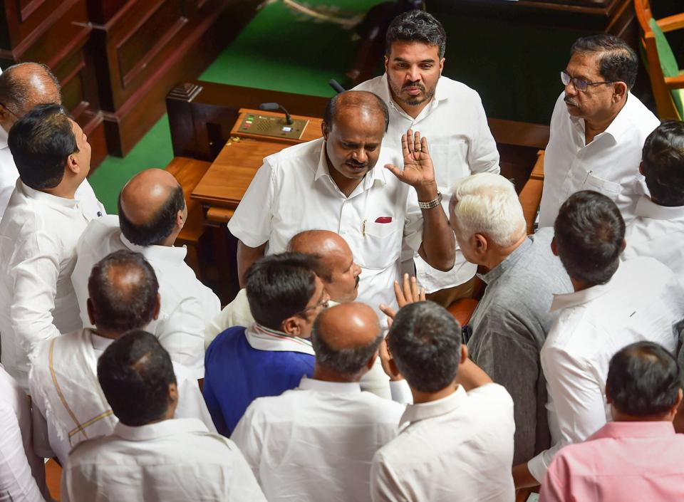 Governor Vajubhai Vala on Friday set a new deadline for Karnataka Chief Minister Kumaraswamy to prove majority in the assembly. This followed a day of fast–paced developments where the Assembly missed the 1.30 deadline set by the governor, who shot off a report on political developments to the Centre soon after. (Shailendra Bhojak / PTI)