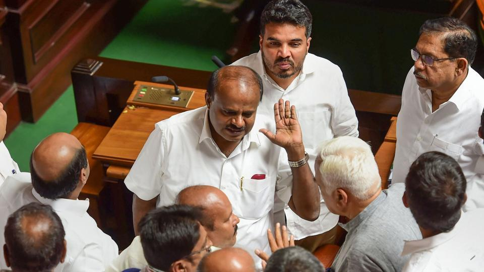 Bengaluru: Karnataka Chief Minister H D Kumaraswamy discusses with his cabinet colleagues after Assembly was adjourned for lunch at Vidhana Soudha, in Bengaluru, Friday, July 19, 2019. (PTI Photo/Shailendra Bhojak)(PTI7_19_2019_000123A)