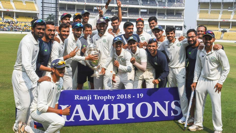Vidarbha team poses with the trophy after defeating Saurashtra in the final cricket match of the Ranji Trophy 2018- 19.