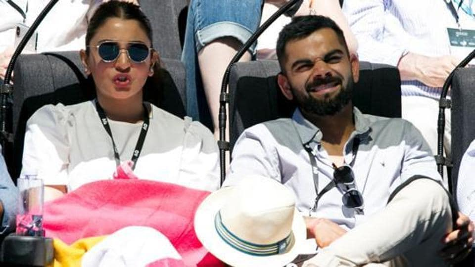 This handout photo taken and released by Tennis Australia shows Indian cricket captain Virat Kohli and his wife Anushka Sharma