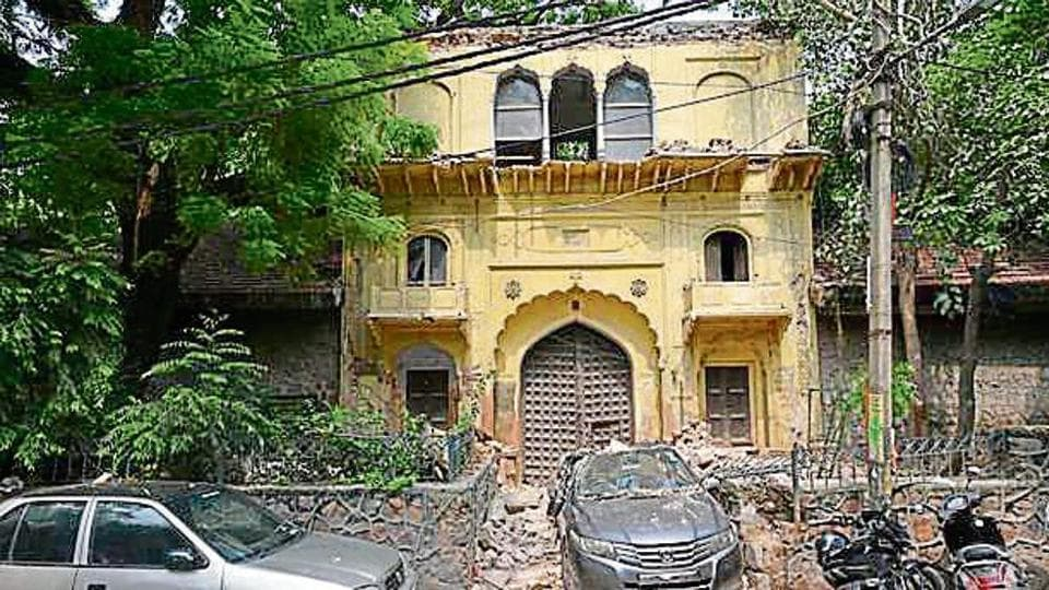 Part of a 18th century gateway in East of Kailash's Garhi village came crashing on a car parked underneath it.