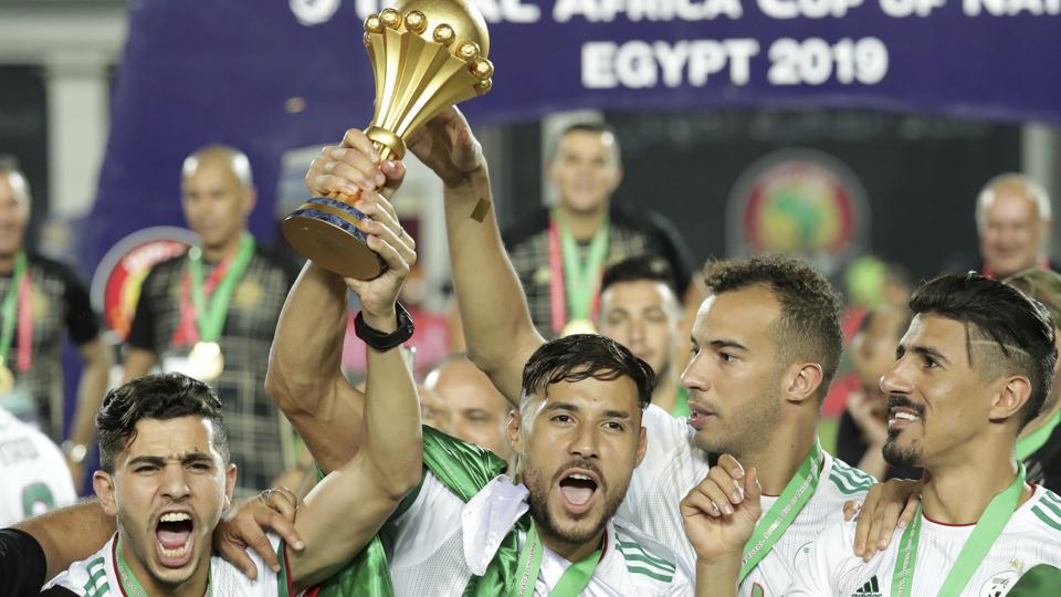 Algeria's players celebrates with the trophy at the end of the African Cup of Nations final soccer match between Algeria and Senegal in Cairo International stadium in Cairo, Egypt, Friday, July 19, 2019. Algeria won 1-0.