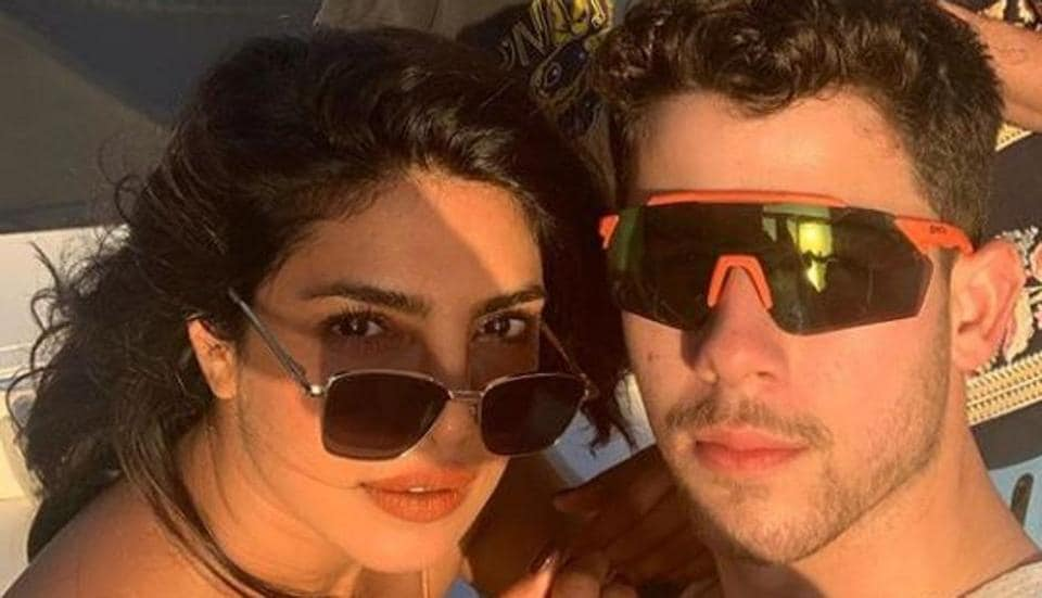 Priyanka Chopra rides water scooter in a pink bikini, parties on a yacht with Nick Jonas and her family in Miami. See pics