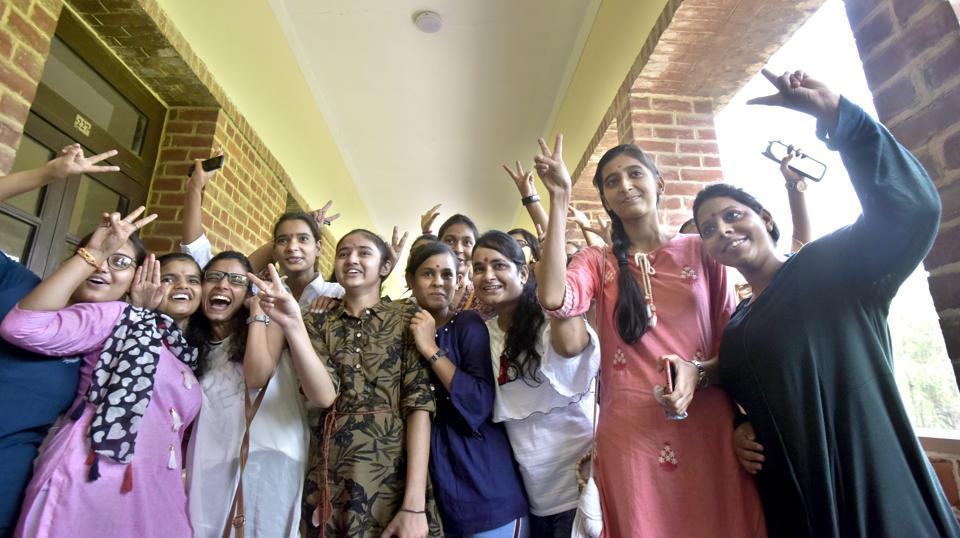 The first year students enjoy on the first day of the new academic session, at Miranda House College, North Campus, in New Delhi, India, on Saturday