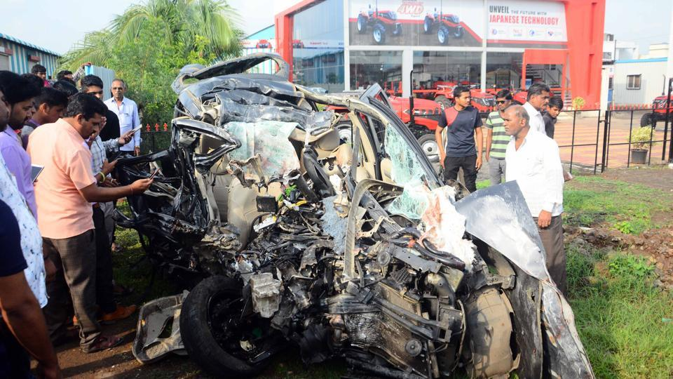Mangled remains of the victims' car that collided head-on with a truck on the Pune-Solapur highway near Loni Kalbhor on Saturday.