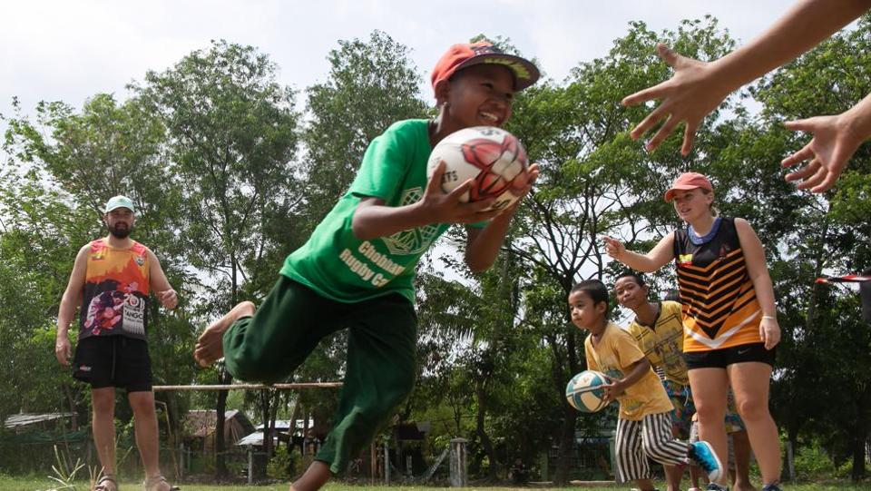Players from the Little Dragons rugby team take part in a training session in the North Dagon township, located on the outskirts of Yangon. Sidestepping cowpats and garbage, Myanmar's only home-grown junior rugby side train on the outskirts of Yangon, preparing to take on children from the city's well-heeled international schools. (Sai Aung Main / AFP)