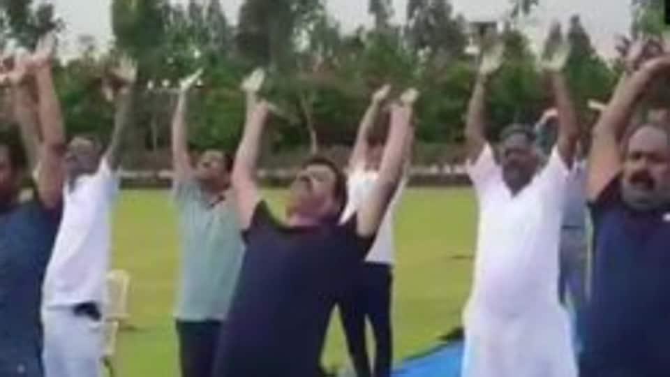 BJPMLAs performing yoga at the Ramada hotel in Bengaluru on Sunday, July 21, 2019.