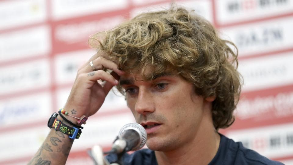 Barcelona's Antoine Griezmann answers a question during a press conference in Tokyo Monday, July 22, 2019. (AP Photo/Eugene Hoshiko)
