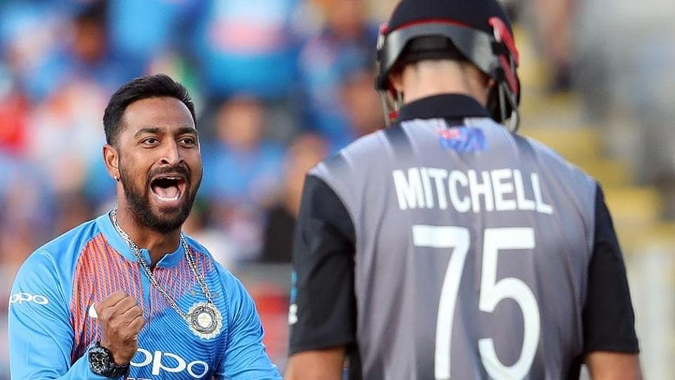 India's Krunal Pandya (L) celebrates the wicket of New Zealand's Daryl Mitchell (R) during the second Twenty20 international cricket match between New Zealand and India in Auckland.