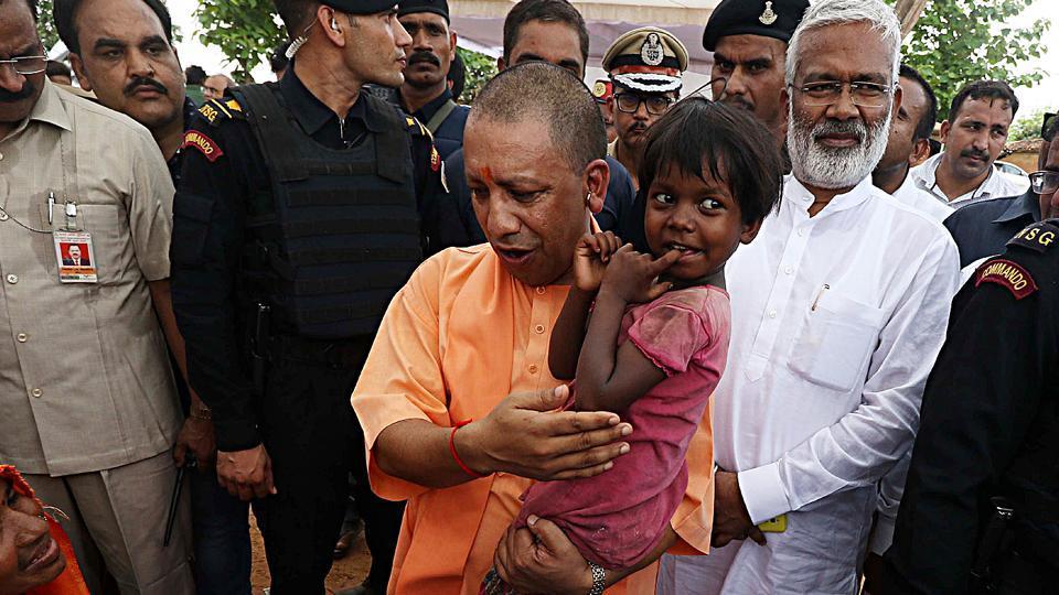 Uttar Pradesh Chief Minister Yogi Adityanath along with Uttar Pradesh BJP State president Swatantra Dev Singh meets with the Umbha Village incident dead and injured victim's family in Village in Sonbhadra on Sunday.