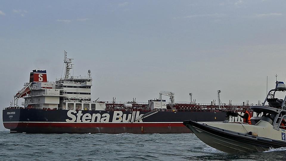 A speedboat and a helicopter of the Iran's Revolutionary Guard move around a British-flagged oil tanker Stena Impero which was seized on Friday by the Guard, in the Iranian port of Bandar Abbas, Sunday, July 21, 2019.