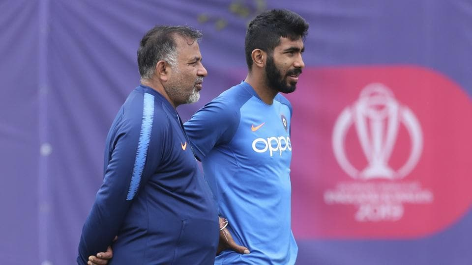 India's Jasprit Bumrah, right, stands with bowling coach Bharat Arun.