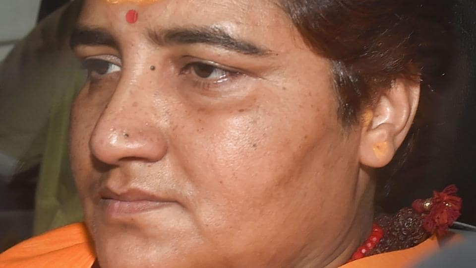 BJP MP Sadhvi Pragya Singh Thakur leaves after a meeting with BJP Working President JP Nadda, at party headquarters in New Delhi on Monday.