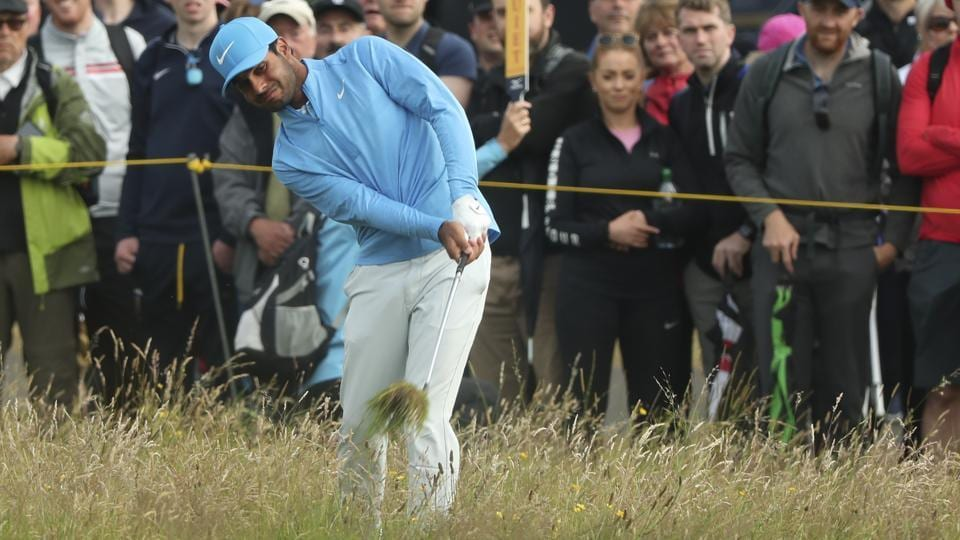 India's Shubhankar Sharma plays out of the rough on the 1st hole.