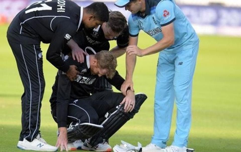 New Zealand batsman Martin Guptill is consoled by teammates and opposition players after he was run out in the super over of the ICC World Cup final between Engalnd and New Zealand.