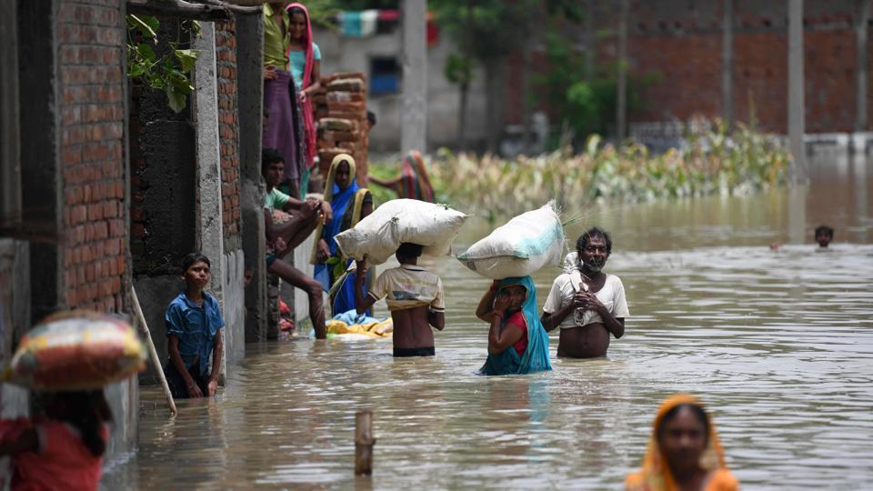 The flood situation in Bihar worsened on Monday after the turbulent waters of Khiroi and Adhwara rivers damaged safety embankments in Darbhanga and Sitamarhi. According to water resources department (WRD) reports, the left embankment of Khiroi near Dhaus and safety embankment of Adhwara in Sitamarhi were damaged partially. Meanwhile the death toll in the current spell of flood in the state has gone up to 102 after recovery of five more bodies on Monday. (Sachin Kumar / AFP File)