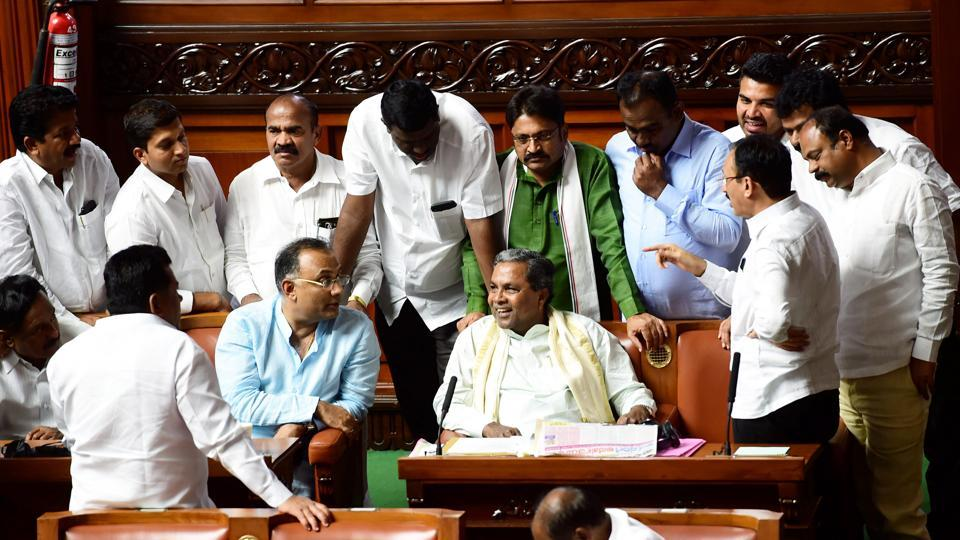 Former Chief Minister Siddaramaiah with party MLAs during assembly session at Vidhana Soudha in Bengaluru on July 22, 2019.
