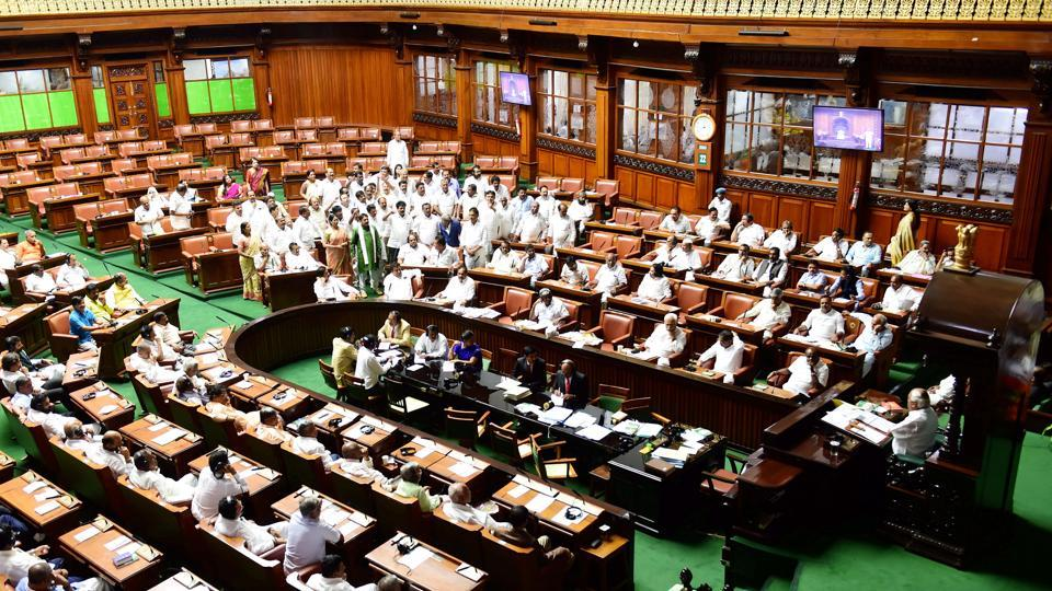 Congress MLAs shout slogans and demand to adjourned the assembly session for the day at Vidhana Soudha in Bengaluru.