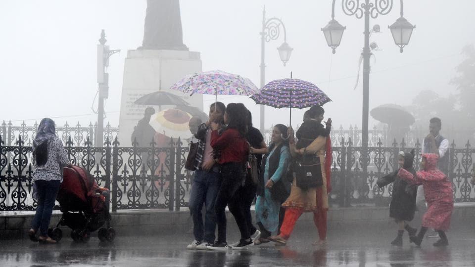 People on the Ridge, Shimla, during rain on Thursday, July 18 2019.
