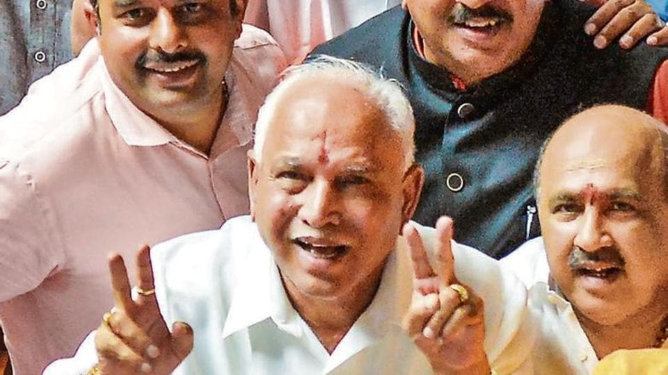 BJP State President BS Yeddyurappa with his party MLAs show victory sign after HD Kumaraswamy lost the vote of confidence