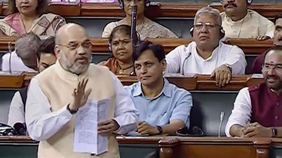 Union Home Minister Amit Shah speaks in the Lok Sabha, during the Budget Session of Parliament, in New Delhi, Wednesday.