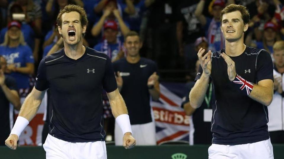 Andy Murray and Jamie Murray celebrate winning their doubles match.