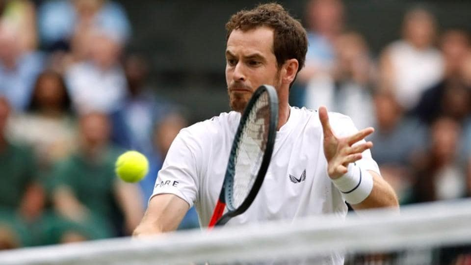 Andy Murray in action during his second round mixed doubles match.