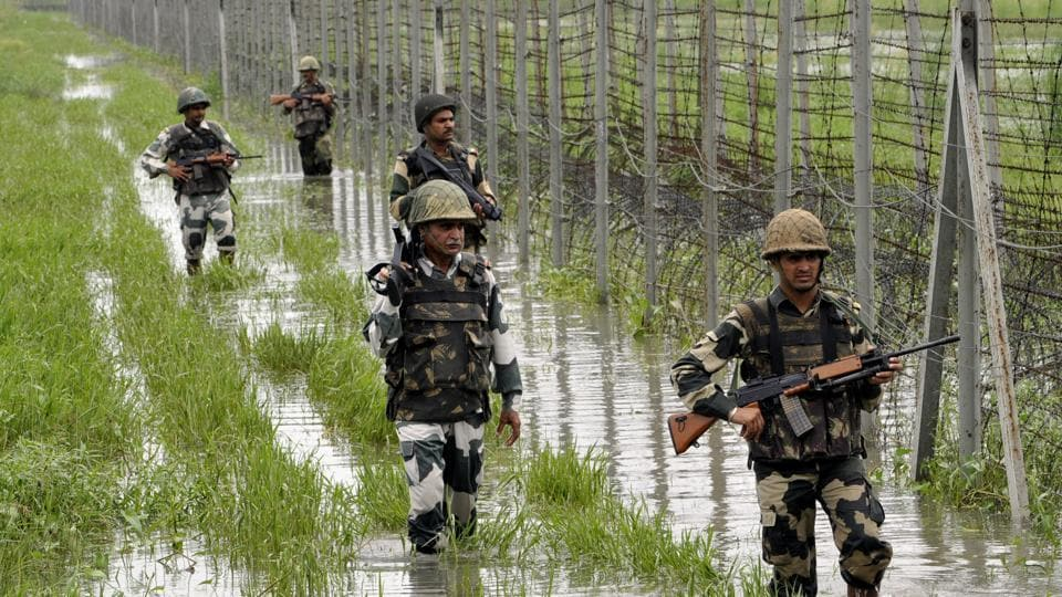 BSF personnel patrol  the fence at International Border at Suchetgarh about 30 km from Jammu.