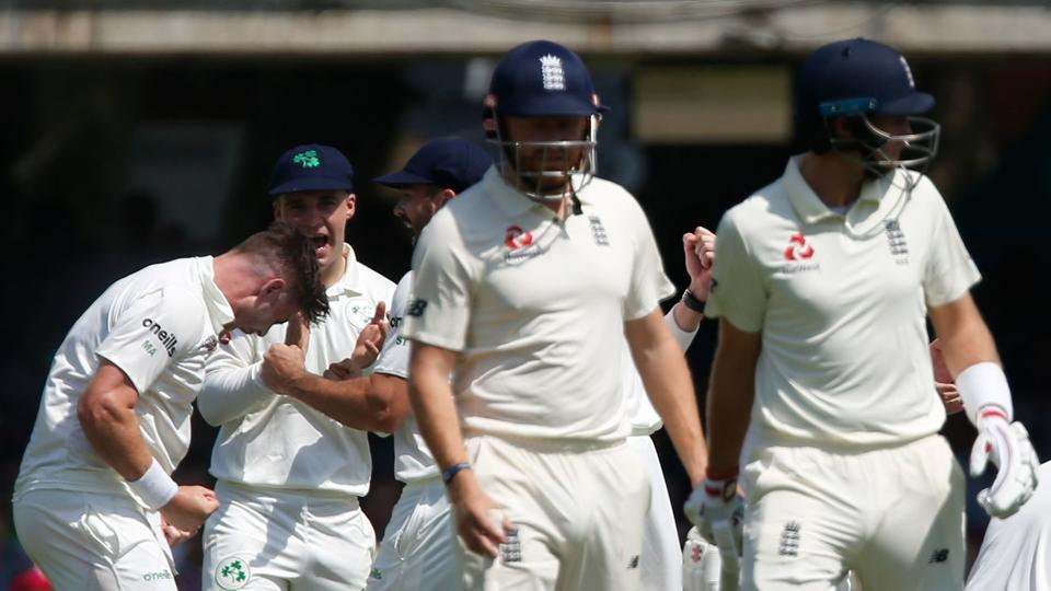 The Irish team celebrate after their appeal for the wicket of England's Joe Root.