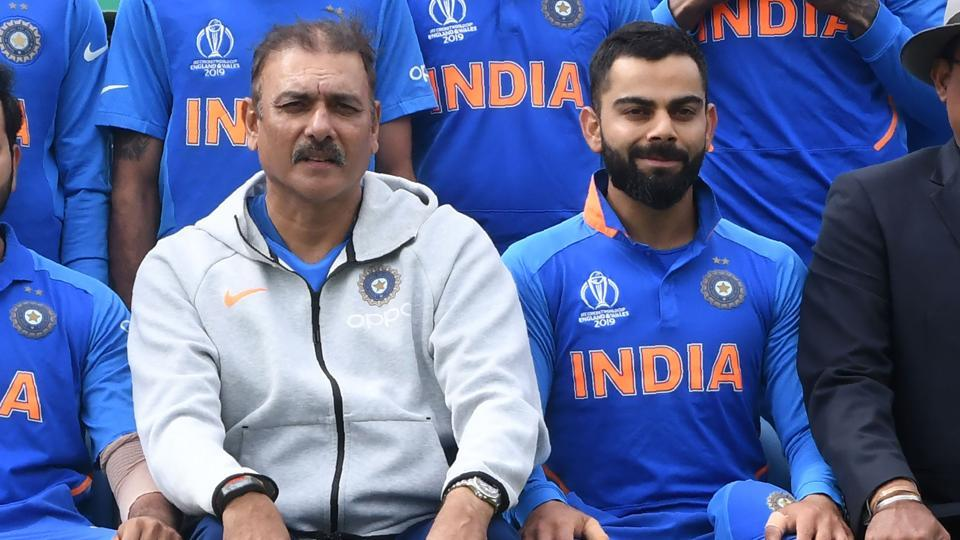 India's head coach Ravi Shastri (L) and India's captain Virat Kohli (R) pose for a group photograph with India team and management ahead of the 2019 Cricket World Cup group stage match between Sri Lanka and India at Headingley in Leeds, northern England, on July 6, 2019.