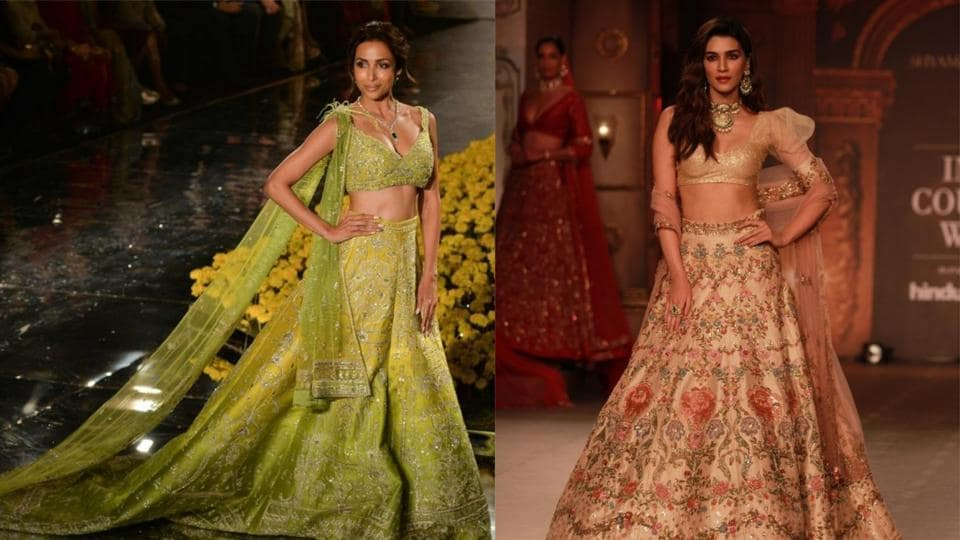 Malaika Arora and Kriti Sanon walk the ramp at FDCI India Couture Week 2019 in Delhi.