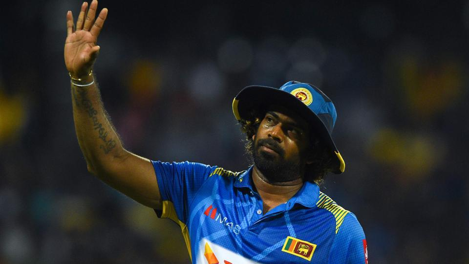 Sri Lankan cricketer Lasith Malinga (C) waves to supporters.
