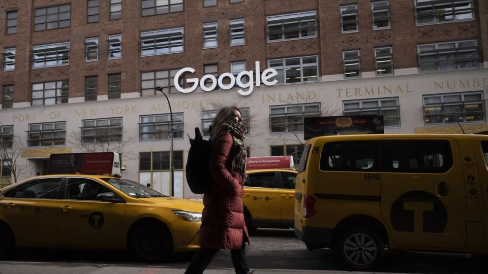 FILE - In this Dec. 17, 2018, file photo a woman walks past Google offices in New York. Alphabet Inc., parent company of Google, reports financial earnings on Thursday, July 25, 2019. (AP Photo/Mark Lennihan, File)