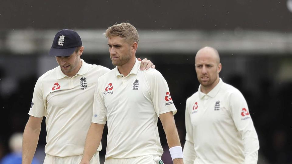 England's Chris Woakes leaves the pitch with team mates.