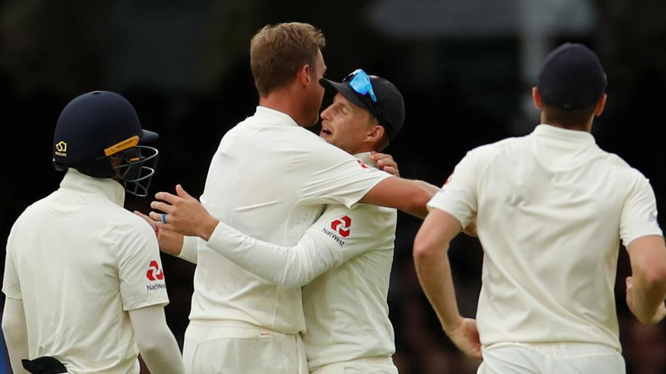 England's Joe Root celebrates with team mates after taking the catch to dismiss Ireland's Andy Balbirnie.