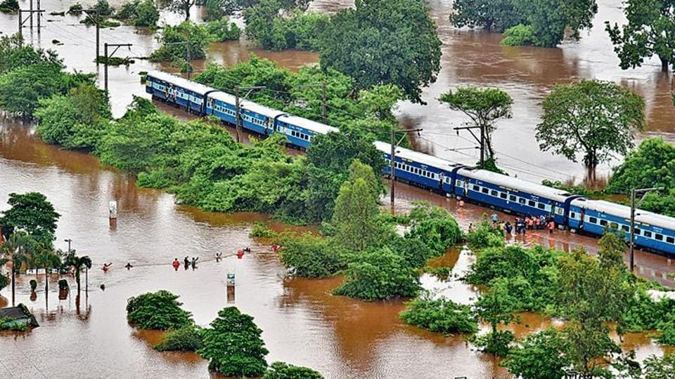 Passengers being rescued from the marooned Mahalaxmi Express in Badlapur, Maharashtra, on Saturday.  (Photo: Indian Navy via AP)