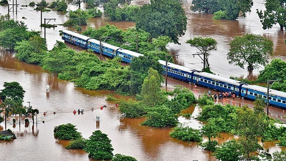 Passengers being rescued from the marooned Mahalaxmi Express in Badlapur, Maharashtra, on Saturday.  (Photo: Indian Navy via AP)