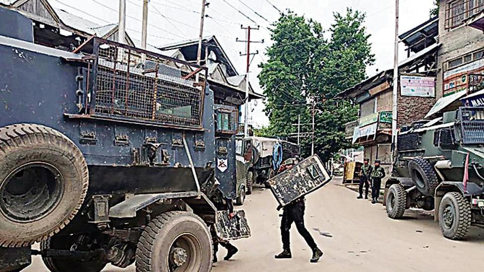 Army personnel in action during an encounter with terrorists in Jammu and Kashmir's Shopian district on Saturday.