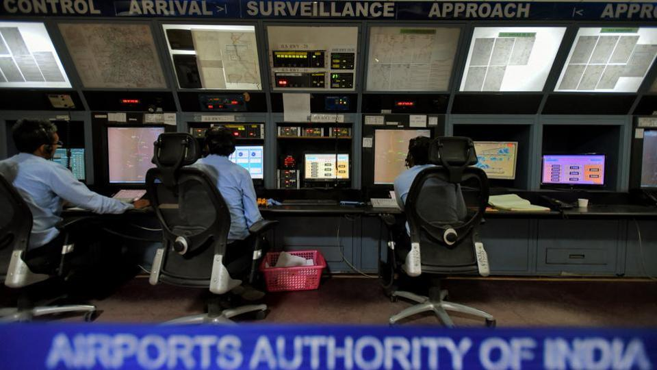 Employees of Airports Authority of India work inside the Air Traffic Control room (ATC), at Indira Gandhi International Airport, in New Delhi.