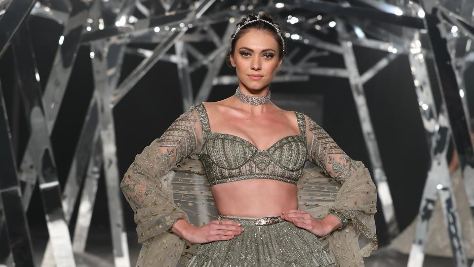 India Couture Week 2019: With a panoply of larger-than-life gowns with sweeping trails, designers Falguni Shane Peacock unravelled a breathtaking show at the ongoing India Couture Week.
