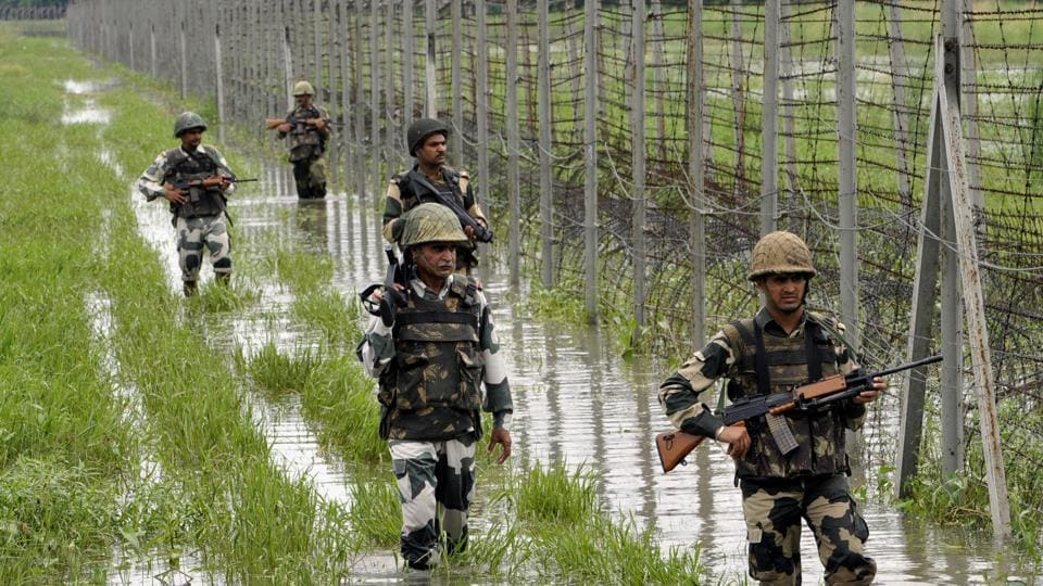 BSF personnel patrolling on the fence at International Border at Suchetgarh about 30 km from Jammu.