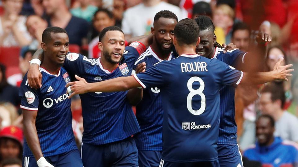 Olympique Lyonnais' Moussa Dembele celebrates scoring their second goal with team mates.