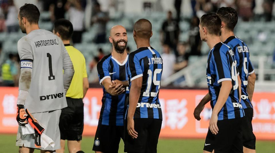 Inter Milan's players celebrate winning the match against Paris St. Germain in a penalty shootout after their International Super Cup football match in Macau on July 27, 2019.