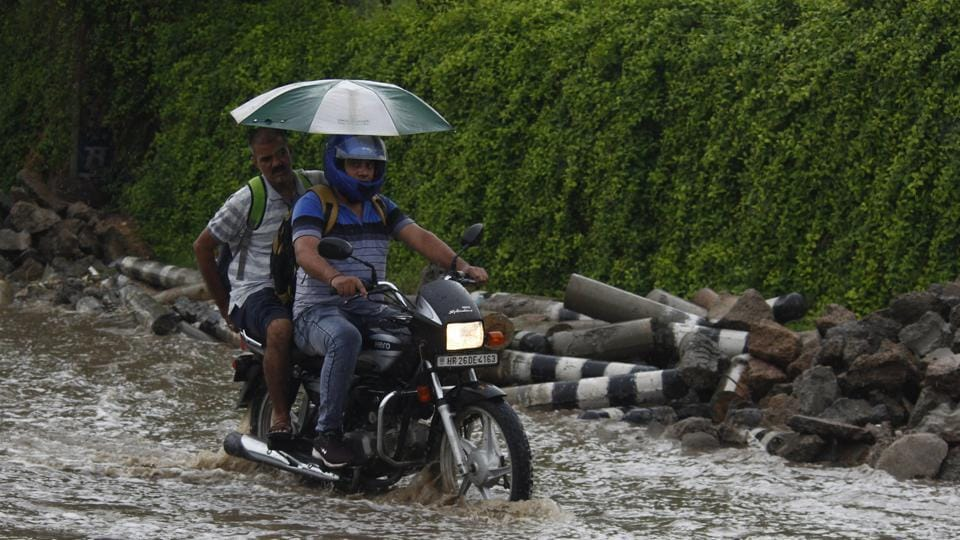 Vehicles move in a slow pace due to waterlogging after morning rain, at National Highway (NH) 48 road, in Gurugram on July 18.