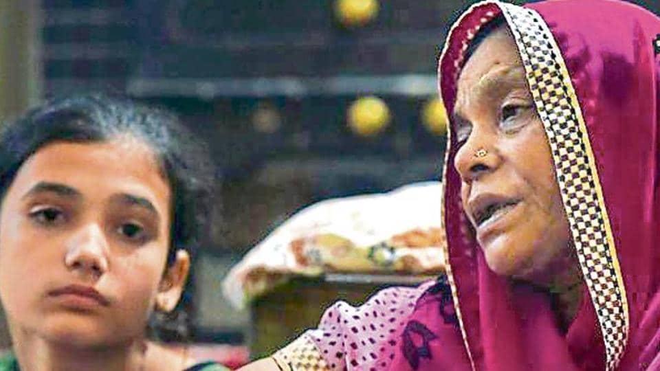 Kusum Lata (R), wife of Atma Ram who died during the Shrikhand Mahadev yatra in Kullu, at Delhi's Seelampur on Sunday.
