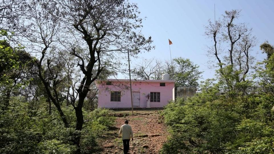 A man walks towards a temple where according to police an eight-year-old girl was held captive for a week and raped before being murdered in January, in Kathua near Jammu.