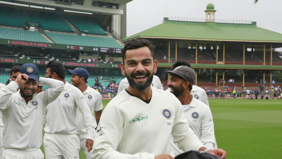 Virat Kohli and the Indian cricket team celebrate winning the series and the Border–Gavaskar Trophy during day five of the Fourth Test match in the series between Australia and India at Sydney Cricket Ground .