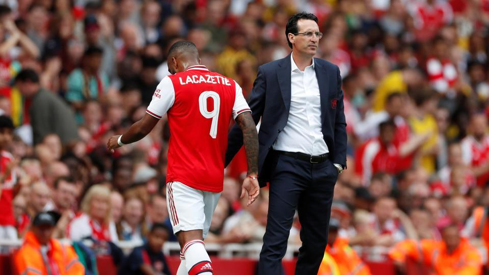 Arsenal manager Unai Emery with Alexandre Lacazette.