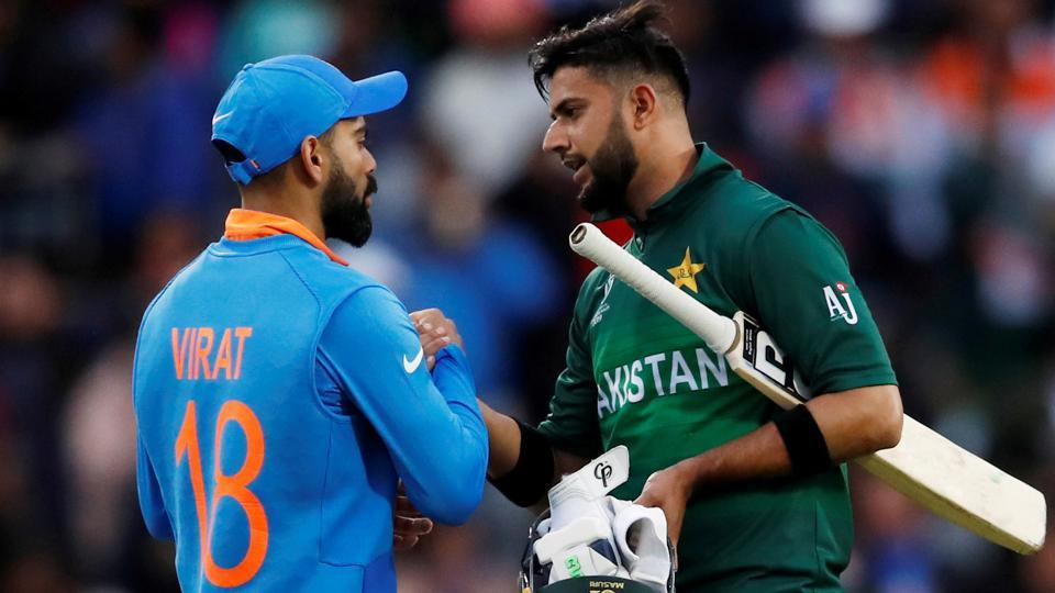 India's Virat Kohil shakes hands with Pakistan's Imad Wasim.