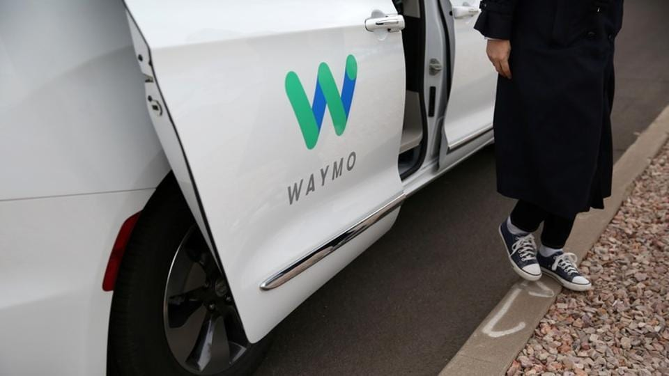 Reuters reporter Alexandria Sage steps out of a Waymo self-driving vehicle during a demonstration in Chandler, Arizona, November 29, 2018. REUTERS/Caitlin O'Hara